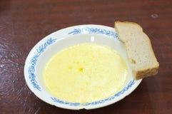 Porridge del miglio con pane Fotografia Stock