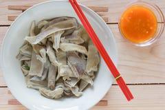 Porridge dello stomaco della carne di maiale con salsa Fotografia Stock