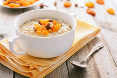 Porridge with dried apricots Stock Photos