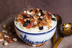 Porridge with dried fruit and nuts. On the plate Royalty Free Stock Photography