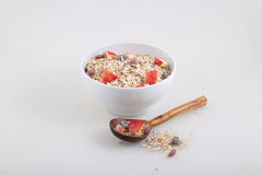 Porridge with dried fruits, nuts and a fresh apple Royalty Free Stock Photos