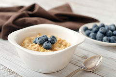 Porridge with fresh blueberry Stock Photos