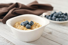 Porridge with fresh blueberry Stock Images