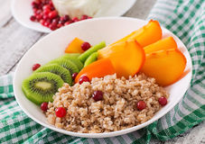 Porridge with fresh fruit and cranberries. Healthy breakfast. Stock Photo