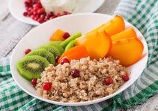 Porridge with fresh fruit and cranberries. Healthy breakfast. Stock Photo