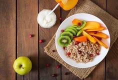 Porridge with fresh fruit and cranberries. Healthy breakfast. Stock Image