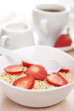 Porridge with fresh strawberry Stock Image