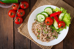 Porridge with fresh vegetables and lettuce. Healthy breakfast. Proper nutrition. Dietary menu. Royalty Free Stock Image