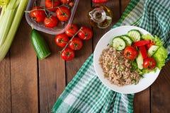Porridge with fresh vegetables and lettuce. Healthy breakfast. Proper nutrition. Dietary menu. Stock Images