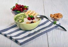 Porridge with fruit on wooden background stock photography