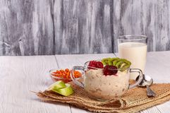 Porridge with fruit on wooden background royalty free stock images