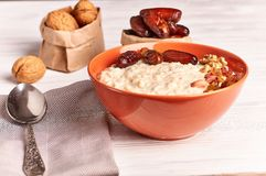 Porridge with fruit on wooden background royalty free stock photography