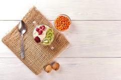 Porridge with fruit on wooden background royalty free stock photo
