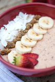 Porridge with fruits and coconut chips Stock Images