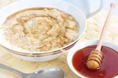 Porridge with honey Stock Photos