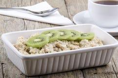 Porridge with kiwi slices Stock Photos