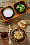 Porridge made with wild rice and black lentils with fried onions Royalty Free Stock Photos