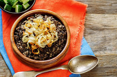 Porridge made with wild rice and black lentils with fried onions Stock Photo