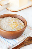 Porridge with melting butter Royalty Free Stock Photography