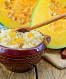 Porridge millet with pumpkin and spoon Stock Photos
