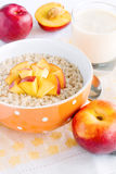 Porridge with nectarine and yogurt Royalty Free Stock Images