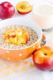 Porridge with nectarine and yogurt Royalty Free Stock Images