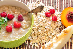 Porridge of oat-flakes with berries and fruit Stock Image