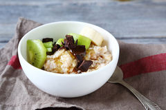 Porridge of oatmeal and fruit Royalty Free Stock Photos