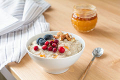 Porridge oats with almonds and berries, close up Royalty Free Stock Image