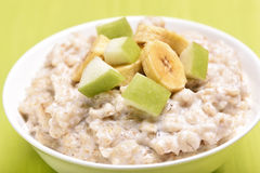 Porridge oats with apple and bananas slices Stock Photography