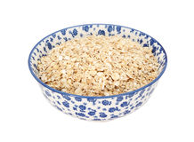 Porridge oats in a blue and white china bowl Stock Images