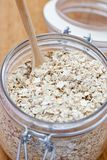 Porridge oats in a glass jar Stock Image