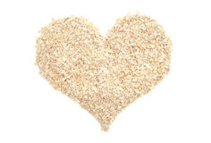 Porridge oats in a heart shape Royalty Free Stock Image