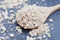 Porridge oats on a wooden spoon Stock Photo