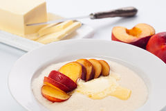 Porridge with peach Stock Photo