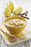 Porridge with pear and cinnamon Stock Photo