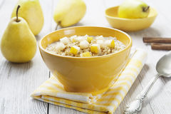 Porridge with pear and cinnamon Royalty Free Stock Image