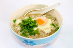 Porridge with pork, star egg royalty free stock photography