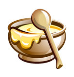 Porridge in the pot with wooden spoon Royalty Free Stock Image