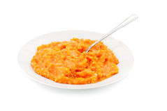 Porridge pumpkin and steel spoon Stock Photos