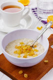Porridge with raisin. In a bowl on the table Stock Images