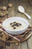 Porridge with raisins and walnuts Royalty Free Stock Photo