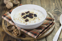 Porridge with raisins and walnuts Stock Photography