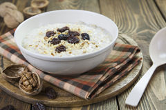 Porridge with raisins and walnuts Royalty Free Stock Images