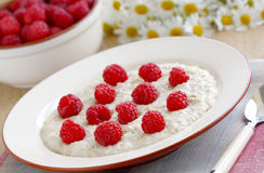 Porridge with raspberries Royalty Free Stock Photography