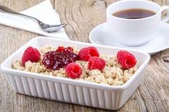 Porridge with raspberry and jam Royalty Free Stock Photo