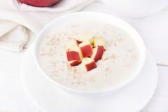 Porridge with red apple slices Royalty Free Stock Photos