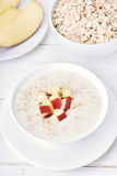 Porridge with red apple slices Stock Photography
