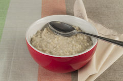 Porridge in the red bowl ball. Healthy food for Breakfast Royalty Free Stock Photography