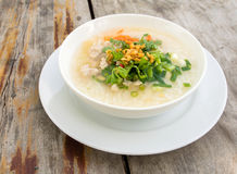 Porridge rice gruel in bowl. Royalty Free Stock Photography